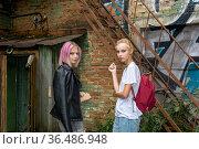 Two teenage girls retired in the courtyard of an old building. Стоковое фото, фотограф Евгений Харитонов / Фотобанк Лори