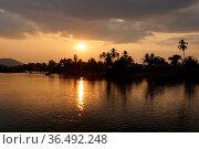 Sundown on Ban Khone village, Don Khone Island within the Mekong river... Стоковое фото, фотограф Zoonar.com/Alexander Ludwig / easy Fotostock / Фотобанк Лори