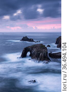 Enys Dodnan sea arch and the Armed Knight rock, Land's End, Cornwall, UK. October 2016. Стоковое фото, фотограф Ross Hoddinott / Nature Picture Library / Фотобанк Лори