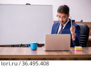 Young handsome employer in teleconference concept. Стоковое фото, фотограф Elnur / Фотобанк Лори