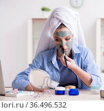 Woman applying clay mask with brush at home. Стоковое фото, фотограф Elnur / Фотобанк Лори