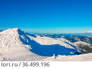 Sunny weather and cloudless blue sky. A lot of snow on the peaks and... Стоковое фото, фотограф Zoonar.com/Mikhail Pavlov / easy Fotostock / Фотобанк Лори