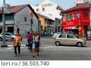 Georgetown, Penang, Malaysia - April 18, 2016 : few local people ... Стоковое фото, фотограф Zoonar.com/PAUL WASCHTSCHENKO / age Fotostock / Фотобанк Лори