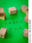 Thank you mit Stempeln auf gruenem Hintergrund. Стоковое фото, фотограф Zoonar.com/Barbara Neveu / easy Fotostock / Фотобанк Лори
