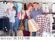 wife and husband with purchases in bags at apparel store. Стоковое фото, фотограф Яков Филимонов / Фотобанк Лори