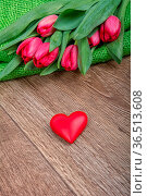 Violet tulip and red heart on a wooden background. Стоковое фото, фотограф Zoonar.com/Jiri Plistil / easy Fotostock / Фотобанк Лори