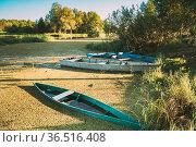 Wooden Rowing Fishing Boats Moored Near River Bog Marsh Coast In Beautiful... Стоковое фото, фотограф Ryhor Bruyeu / easy Fotostock / Фотобанк Лори