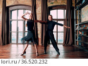 Young couple boy and girl dancing in ballroom dance Rumba. Стоковое фото, фотограф Zoonar.com/Max / easy Fotostock / Фотобанк Лори