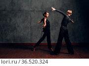 Young couple dancing in ballroom dance Paso doble. Стоковое фото, фотограф Zoonar.com/Max / easy Fotostock / Фотобанк Лори