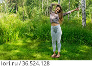 Young woman stands on a board with nails doing yoga practice outdoors. Стоковое фото, фотограф Евгений Харитонов / Фотобанк Лори