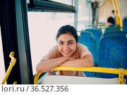 Indian Smiling Positive Woman ride in public transport bus or tram. Стоковое фото, фотограф Zoonar.com/Max / easy Fotostock / Фотобанк Лори