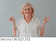 Elderly caucasian old aged woman portrait meditating and smiling with... Стоковое фото, фотограф Zoonar.com/Max / easy Fotostock / Фотобанк Лори