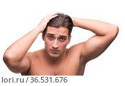Man brushing his hair isolated on white. Стоковое фото, фотограф Elnur / Фотобанк Лори