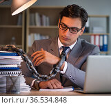Businessman staying in the office for long hours. Стоковое фото, фотограф Elnur / Фотобанк Лори