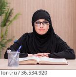 Woman muslim student preparing for exams. Стоковое фото, фотограф Elnur / Фотобанк Лори