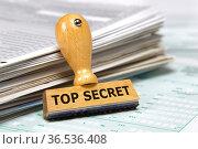 Top secret documents with rubber stamp. Стоковое фото, фотограф Zoonar.com/Wolfilser / easy Fotostock / Фотобанк Лори
