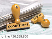 Terms and conditions marked on rubber stamp. Стоковое фото, фотограф Zoonar.com/Wolfilser / easy Fotostock / Фотобанк Лори