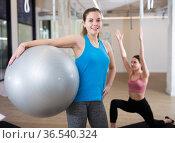 Woman standing with pilates ball at gym. Стоковое фото, фотограф Яков Филимонов / Фотобанк Лори