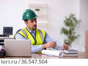 Young male architect working in the office. Стоковое фото, фотограф Elnur / Фотобанк Лори
