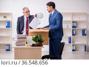 Two male employees in dismissal concept. Стоковое фото, фотограф Elnur / Фотобанк Лори