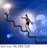 Businesswoman climbing career ladder towards light bulb. Стоковое фото, фотограф Elnur / Фотобанк Лори