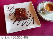 Piece of chocolate cake served on white plate. Стоковое фото, фотограф Яков Филимонов / Фотобанк Лори