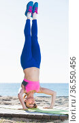 Woman exercising of yoga on the beach. Стоковое фото, фотограф Яков Филимонов / Фотобанк Лори