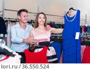 Shoppers are choosing dress for her. Стоковое фото, фотограф Яков Филимонов / Фотобанк Лори