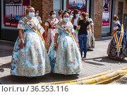 Falleras with mask. Torrent. Spain. Fallas September 2021. 500 days... Редакционное фото, фотограф Empar Bessó / age Fotostock / Фотобанк Лори