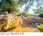 Adult woman is running away being stalked. Стоковое фото, фотограф Emil Pozar / age Fotostock / Фотобанк Лори