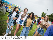 A happy, diverse group of girl friends hang out in the midway at ... Редакционное фото, фотограф Lori Epstein / age Fotostock / Фотобанк Лори