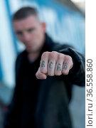 ACAB tattoo on the arm of a bully man. Kyiv. Ukraine. Стоковое фото, фотограф Zoonar.com/Mykola Kondrashev / easy Fotostock / Фотобанк Лори