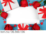 Roses hearts and gifts on greeting card border frame with copy space... Стоковое фото, фотограф Zoonar.com/Ivan Mikhaylov / easy Fotostock / Фотобанк Лори
