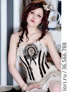 Junge Frau im Designer Vintage Kostüm in einem Zimmer mit gestreiften... Стоковое фото, фотограф Zoonar.com/Lars Patzek / easy Fotostock / Фотобанк Лори