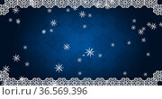 Digital image of christmas tradition frame over snow flakes falling against blue background. Стоковое фото, агентство Wavebreak Media / Фотобанк Лори