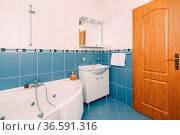 Bathroom with hydromassage bathtub, washbasin with mirror and brown... Стоковое фото, фотограф Zoonar.com/Nadtochiy.com / easy Fotostock / Фотобанк Лори