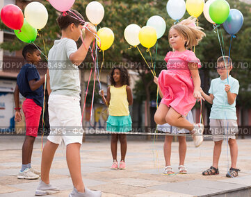 Children playing with balloons and jumping rope