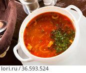 Russian cuisine - solyanka soup with various ingredients. Стоковое фото, фотограф Яков Филимонов / Фотобанк Лори