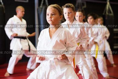 Young boys and girls in kimono doing kata