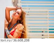 Sexy young blond fashionable woman posing in a red bikini. Стоковое фото, фотограф Zoonar.com/Dasha Petrenko / easy Fotostock / Фотобанк Лори