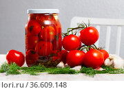 Glass jar with pickled tomatoes on a wooden table. Стоковое фото, фотограф Яков Филимонов / Фотобанк Лори