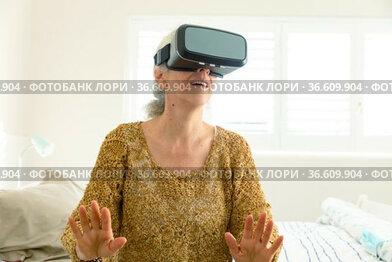 Happy senior caucasian woman wearing vr headset and having fun