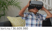 African american boy wearing vr headset and having fun. Стоковое видео, агентство Wavebreak Media / Фотобанк Лори