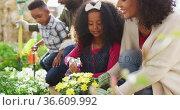 Happy african american parents with children gardening together. Стоковое видео, агентство Wavebreak Media / Фотобанк Лори