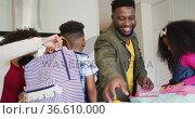 Happy african american parent preparing children for school. Стоковое видео, агентство Wavebreak Media / Фотобанк Лори
