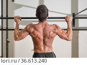 Athlete doing pull-ups at the gym. Handsome man doing functional training... Стоковое фото, фотограф David Herraez Calzada / easy Fotostock / Фотобанк Лори
