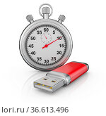 Usb drive and a stopwatch on a white background. Стоковое фото, фотограф Zoonar.com/Roman Ivashchenko / easy Fotostock / Фотобанк Лори