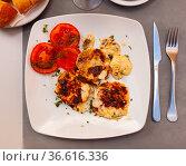 Delicious stuffed scallops with tomatoes closeup. Стоковое фото, фотограф Яков Филимонов / Фотобанк Лори