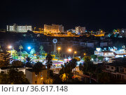 Protaras, Cyprus - Oct 12. 2019. Panorama of the city at night from above. Luna park and mini golf. Редакционное фото, фотограф Володина Ольга / Фотобанк Лори