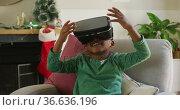 Animation of happy african american boy wearing vr headset and having fun at christmas time. Стоковое видео, агентство Wavebreak Media / Фотобанк Лори